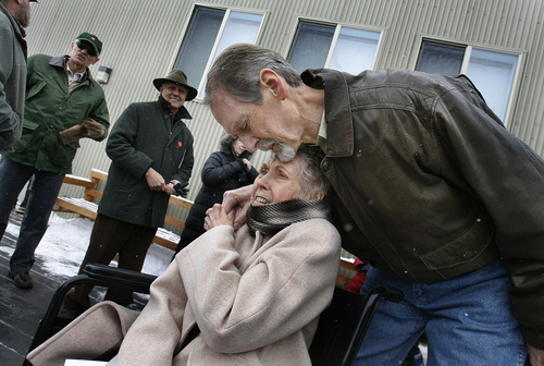 Scott Sommerdorf  |  The Salt Lake Tribune Bob Hasenyager hugs Carolyn Carter as he arrives at the ceremony to rename the Great Salt Lake Nature Center in his honor Saturday, February 9, 2013. Hasenyager is a former DWR employee and the executive director of the Utah Wildlife in Need (UWIN) Foundation. To honor his commitment to wildlife education, the DWR and UWIN Board of Directors renamed the center the Robert N. Hasenyager Great Salt Lake Nature Center.