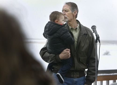 Scott Sommerdorf  |  The Salt Lake Tribune Bob Hasenyager kisses his grandson Braxton Scopel after the one year old walked over to him during his remarks at the ceremony to rename the Great Salt Lake Nature Center in his honor, Saturday, February 9, 2013. Hasenyager is a former DWR employee and the executive director of the Utah Wildlife in Need (UWIN) Foundation. To honor his commitment to wildlife education, the DWR and UWIN Board of Directors renamed the center the Robert N. Hasenyager Great Salt Lake Nature Center.