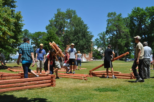 Utah State Parks | Participants in the Building Zion Youth Camp at Territorial Statehouse State Park Museum build pioneer-like cabins.