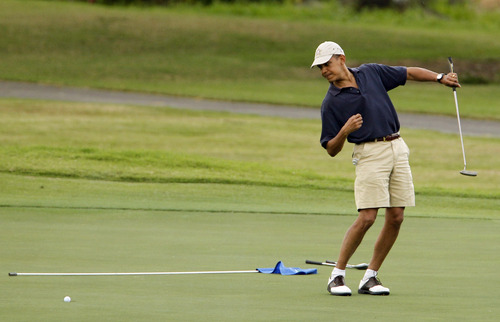FILE - In this Dec. 31, 2009 file photo, President Barack Obama watches the ball after making a putt on the ninth green during his golf match at Mid-Pacific County Club in Kailua, Hawaii. Obama played golf Sunday with Tiger Woods, the White House said Sunday. Once the sport's dominant player before his career was sidetracked by scandal, Woods joined Obama at the Floridian, a secluded and exclusive yacht and golf club on Florida's Treasure Coast where Obama is spending the long Presidents Day weekend. The two had met before, but Sunday was the first time they played together. (AP Photo/Chris Carlson, File)