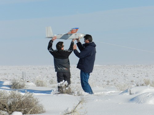 Researchers from Utah State University launch a remote-controlled aircraft to help learn about the unusual chemistry in the Uinta Basin that makes emissions from energy development turn into episodes of unhealthy ozone pollution. Courtesy Randal Martin, Utah State University.
