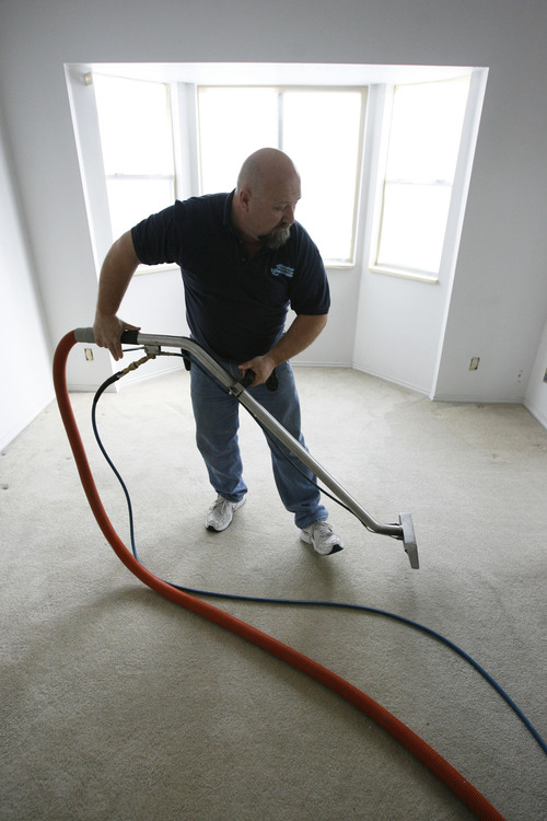 Francisco Kjolseth  |  The Salt Lake Tribune Frank Rudarmel, owner of Anchor Restoration works on a carpet cleaning job in Taylorsville recently. Frank, co-owner along with his wife Kris were awarded with a grant from SCORE and Sam's Club. They received small business training and a $1,000 giftcard to Sam's.