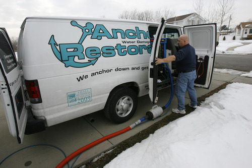 Francisco Kjolseth  |  The Salt Lake Tribune Frank Rudarmel, owner of Anchor Restoration works on a carpet cleaning job in Taylorsville recently. Frank, co-owner along with his wife, Kris, were awarded with a grant from SCORE and Sam's Club. They received small business training and a $1,000 giftcard to Sam's.