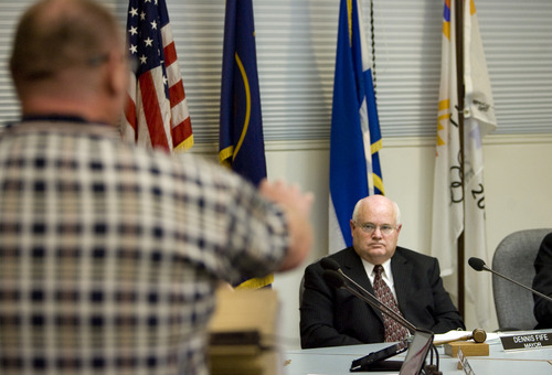 Kim Raff  |  The Salt Lake Tribune Mayor Dennis Fife listens as Mike Allen, left, calls for his resignation due to an affair during a public comment portion of a Brigham City Council meeting in December. Fife is getting pressure from residents to resign as Mayor of the city because of his affair he had with a woman he counseled while LDS Bishop.