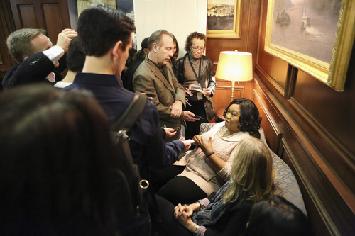 """Shonda Rhimes (seated) takes questions from TV critics on the set of """"Scandal."""""""