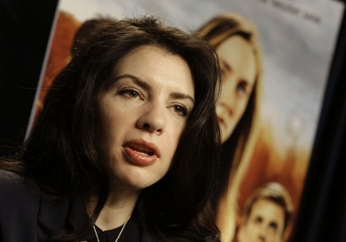 """This Feb. 19, 2013 photo shows author Stephenie Meyer speaking in Miami. Meyer, author of the """"Twilight"""" saga, wrote the novel """"The Host"""" as an escape from editing of one of the books in the popular vampire series. The movie adaption of """"The Host"""" premieres March 29. (AP Photo/Alan Diaz)"""