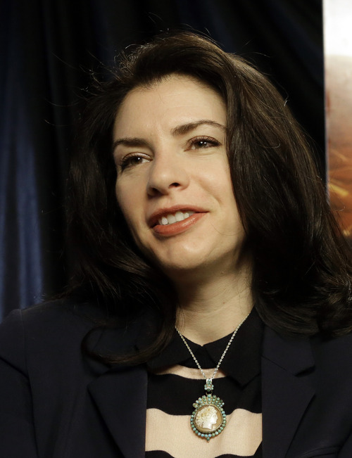 """This Feb. 19, 2013 photo shows author Stephenie Meyer in Miami. Meyer, author of the """"Twilight"""" saga says she's working on a new series. The movie adaption of """"The Host"""" premieres March 29. (AP Photo/Alan Diaz)"""