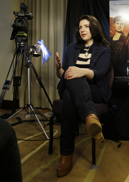 """This Feb. 19, 2013 photo shows author Stephenie Meyer speaking in Miami. The movie adaption of her novel """"The Host"""" premieres March 29. (AP Photo/Alan Diaz)"""