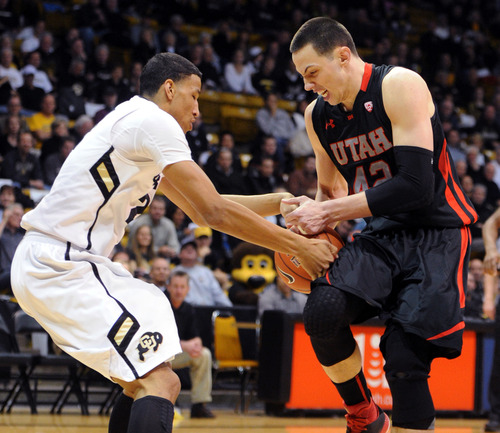 Colorado's Andre Roberson, left , tries to tie up Utah's Jason Washburn during the first half of their NCAA college basketball game, Thursday, Feb. 21, 2013, in Boulder, Colo. (AP Photo/The Daily Camera, Cliff Grassmick) NO SALES; MAGS OUT; TV OUT
