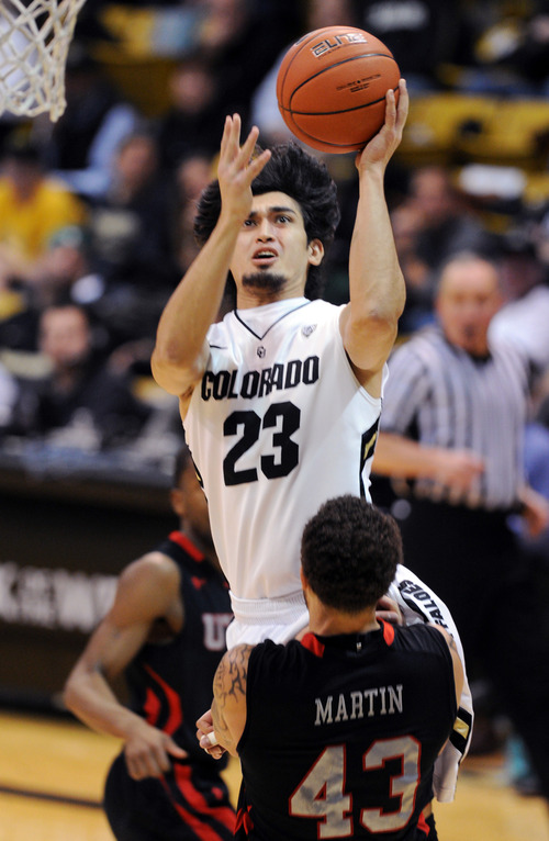 Colorado's Sabatino Chen drives to the basket into Utah's Cedric Martin during the second half of their NCAA college basketball game, Thursday, Feb. 21, 2013, in Boulder, Colo. (AP Photo/The Daily Camera, Cliff Grassmick) NO SALES; MAGS OUT; TV OUT