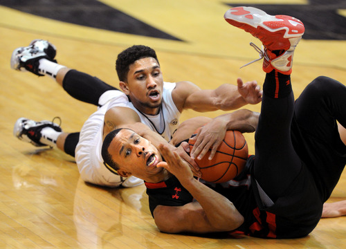 Utah's Brandon Taylor tries to call a timeout before Colorado's Askia Booker can get to the ball during the second half of their NCAA college basketball game, Thursday, Feb. 21, 2013, in Boulder, Colo. (AP Photo/The Daily Camera, Cliff Grassmick) NO SALES; MAGS OUT; TV OUT