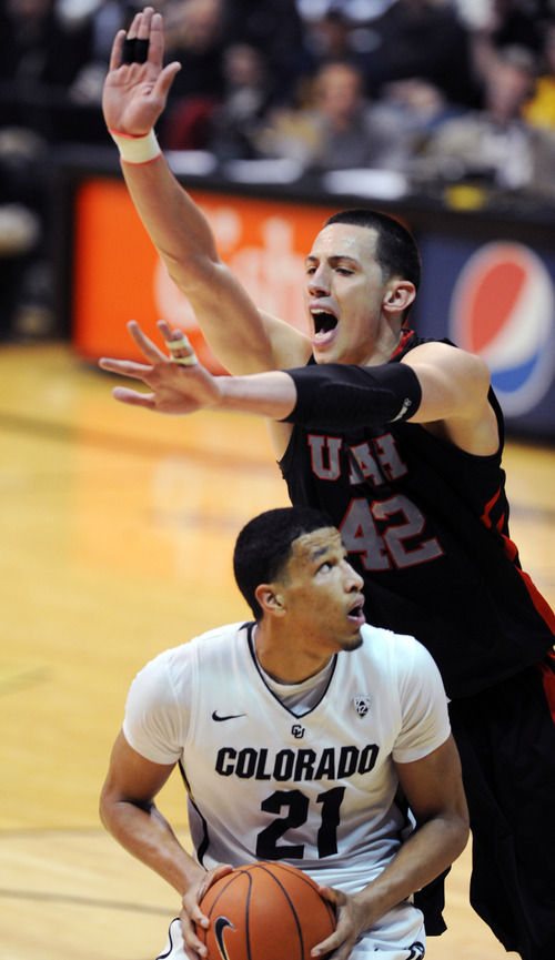 Colorado's Andre Roberson looks to shoot on Utah's Jason Washburn during the second half of their NCAA college basketball game, Thursday, Feb. 21, 2013, in Boulder, Colo. (AP Photo/The Daily Camera, Cliff Grassmick) NO SALES; MAGS OUT; TV OUT