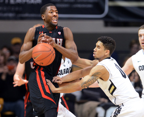 Colorado's Askia Booker, right, knocks the ball from Utah's Jarrod DuBois during the first half of their NCAA college basketball game, Thursday, Feb. 21, 2013, in Boulder, Colo. (AP Photo/The Daily Camera, Cliff Grassmick) NO SALES; MAGS OUT; TV OUT