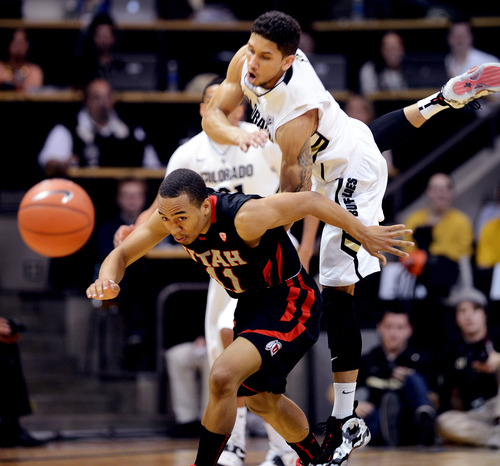 An inbounds pass gets over Colorado's Askia Booker, top, and Utah's Brandon Taylor during the first half of their NCAA college basketball game, Thursday, Feb. 21, 2013, in Boulder, Colo. (AP Photo/The Daily Camera, Cliff Grassmick) NO SALES; MAGS OUT; TV OUT