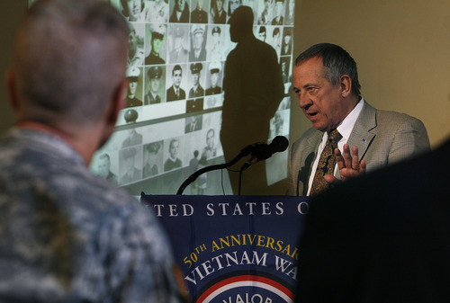 Scott Sommerdorf   |  The Salt Lake Tribune President of the Vietnam Veterans Memorial, Jan C. Scruggs, speaks about the attempt to procure photos of some of the missing Utah citizens who are listed on the Vietnam Veterans Memorial in Washington, D.C., Wednesday, February 20, 2013. Behind Scruggs is a representation of how those photos may be presented at the memorial once they are collected.