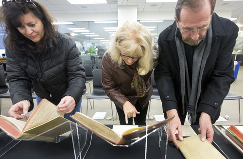 Lennie Mahler  |  The Salt Lake Tribune Robyn Anderson, Leslie Cheminant and Robert Cheminant examine some of the first edition ancient astronomy books in the special collections area of the Marriott Library, Wednesday, Jan. 30, 2013.