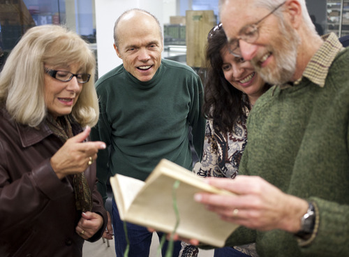 Lennie Mahler  |  The Salt Lake Tribune Leslie Cheminant, Patrick Wiggins, Robyn Anderson and Fred Swanson examine an astronomy book in the special collections area of the Marriott Library, Wednesday, Jan. 30, 2013.