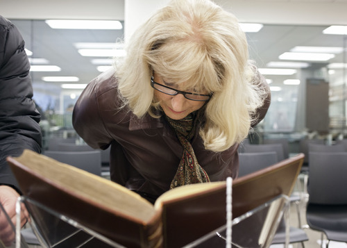 "Lennie Mahler  |  The Salt Lake Tribune Leslie Cheminant examines a first edition of Frances Bacon's ""Novum Organum"" in the special collections area of the Marriott Library, Wednesday, Jan. 30, 2013."