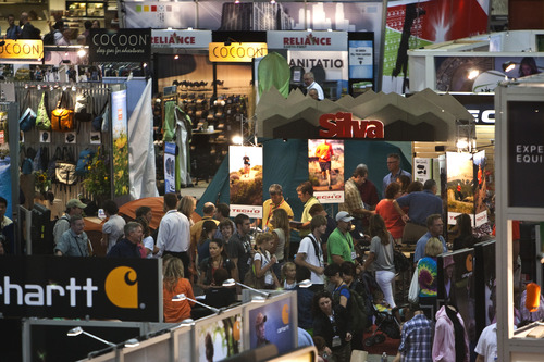 Photo by Chris Detrick  |  Tribune file photo People walk around thousands of exhibitors during the Outdoor Retailer Summer Market at the Salt Palace Convention Center in 2010.