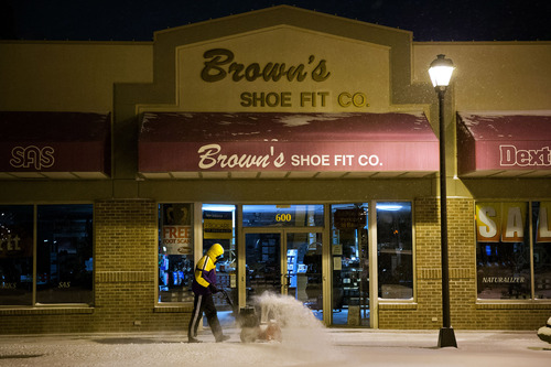 Denoy Smith, manager of Brown's Shoe Fit Co.  removes snow from the store's sidewalk Thursday Feb. 21, 2013, in Hastings Neb.  Winter storm warnings were issued from eastern Colorado through Illinois Thursday. (AP Photo/ The Omaha World-Herald/Ryan Soderlin) MAGS OUT TV OUT