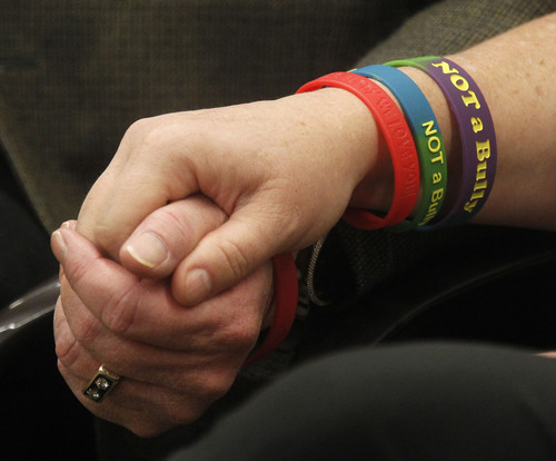 Al Hartmann  |  The Salt Lake Tribune Bud and Karen Peterson hold hands at the House Education Committee for passage of HB134 that would require parental notification when a student has been involved in a threat of suicide or violence.  Their son Buddy committed sucide from bullying.