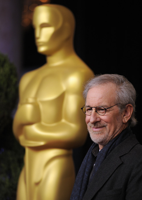 "FILE - In this Monday, Feb. 4, 2013 photo, Steven Spielberg, nominated for directing and best picture for ""Lincoln,"" arrives at the 85th Academy Awards Nominees Luncheon at the Beverly Hilton Hotel, in Beverly Hills, Calif.  ""Lincoln"" leads the field with 12 Academy Awards nominations, including one for director Steven Spielberg. The 85th Academy Awards will be held in Los Angeles on Sunday, Feb. 24. (Photo by Chris Pizzello/Invision/AP, File)"