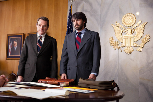 "FILE - This undated publicity film image released by Warner Bros. Pictures shows Bryan Cranston, left, as Jack O'Donnell and Ben Affleck as Tony Mendez in ""Argo,""  a rescue thriller about the 1979 Iranian hostage crisis.  A best-picture win at the upcoming Oscars could be viewed as righting a wrong after Affleck inexplicably missed out on a best-director nomination.  (AP Photo/Warner Bros., Claire Folger, File)"
