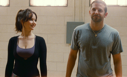 """FILE -This film image released by The Weinstein Company shows Jennifer Lawrence, left, and Bradley Cooper in """"Silver Linings Playbook."""" Lawrence is nominated for an Academy Award for best actress for """"Silver Linings Playbook."""" The 85th Academy Awards are held in Los Angeles on Sunday, Feb. 24. (AP Photo/The Weinstein Company, JoJo Whilden, File)"""