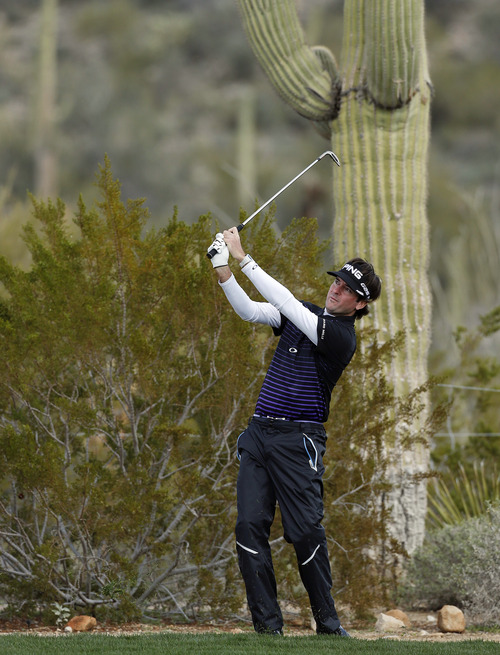 Bubba Watson hits a shot out of the rough off the 10th fairway in the first round against Chris Wood, of England, during the Match Play Championship golf tournament, Thursday, Feb. 21, 2013, in Marana, Ariz. (AP Photo/Ross D. Franklin)