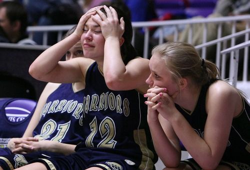 Leah Hogsten  |  The Salt Lake Tribune Snow Canyon's Lauren Smith and her teammates react to the loss. Desert Hills High School defeated Snow Canyon High School 40-30 during their 3A Utah High School Girls Basketball semifinal matchup at Weber State University, February 22, 2013.