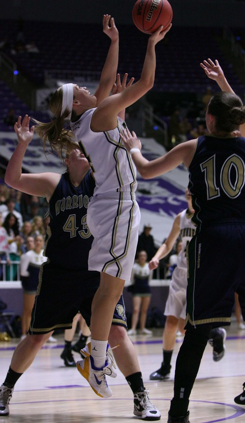 Leah Hogsten  |  The Salt Lake Tribune Desert Hills' Blair Bliss lays one up backwards. Bliss had 20points in the game. Desert Hills High School defeated Snow Canyon High School 40-30 during their 3A Utah High School Girls Basketball semifinal matchup at Weber State University, February 22, 2013.