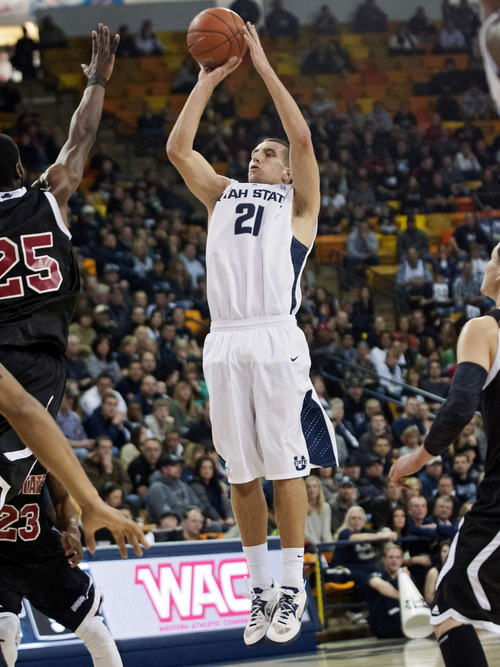 Utah State's Spencer Butterfield takes a jump-shot against New Mexico State in the first half of an NCAA college basketball game on Saturday, Feb. 16, 2103, in Logan, Utah. (AP Photo/Herald Journal, Jennifer Meyers)