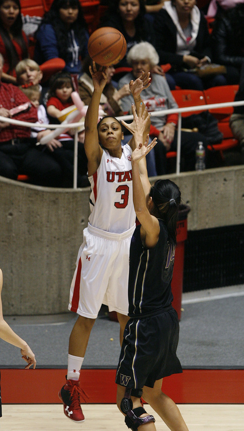 Scott Sommerdorf   |  The Salt Lake Tribune Utah's Iwalani Rodrigues shoots for two of her 17 points during second half play. Utah beat Washington 60-46, Friday, February 22, 2013.