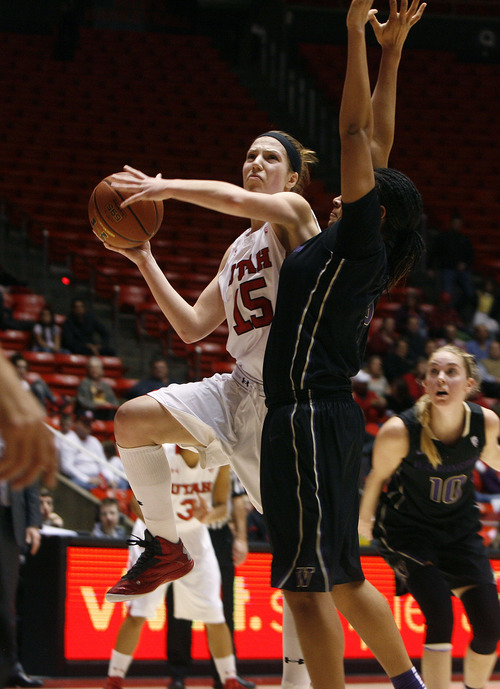 Scott Sommerdorf   |  The Salt Lake Tribune Michelle Plouffe drives during first half play. Utah beat Washington 60-46, Friday, February 22, 2013.