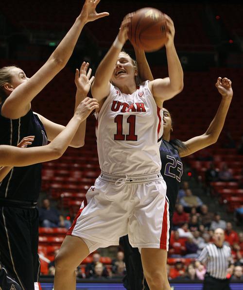 Scott Sommerdorf   |  The Salt Lake Tribune Utah's Taryn Wicijowski battles for control of a rebound during first half play. Utah beat Washington 60-46, Friday, February 22, 2013.