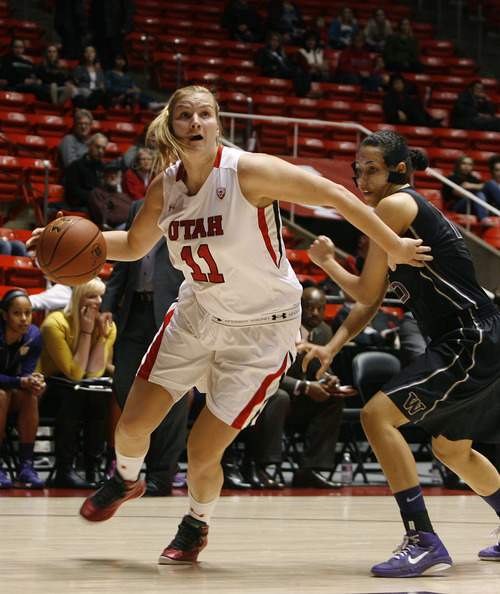 Scott Sommerdorf   |  The Salt Lake Tribune Utah's Taryn Wicijowski spins around to go to the hoop after grabbing a first half rebound as Utah beat Washington 60-46, Friday, February 22, 2013.