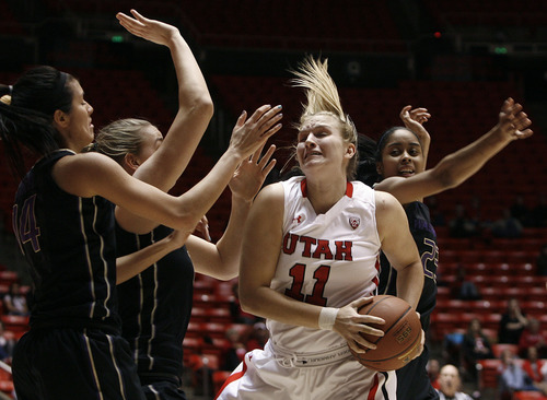 Scott Sommerdorf   |  The Salt Lake Tribune Uaths' Taryn Wicijowski is triple-teamed after grabbiong a rebond during first half play. Utah beat Washington 60-46, Friday, February 22, 2013.
