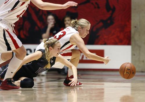 Scott Sommerdorf   |  The Salt Lake Tribune Utah's Rachel Messer dives for a loose ball during first half play as Utah beat Washington 60-46, Friday, February 22, 2013.