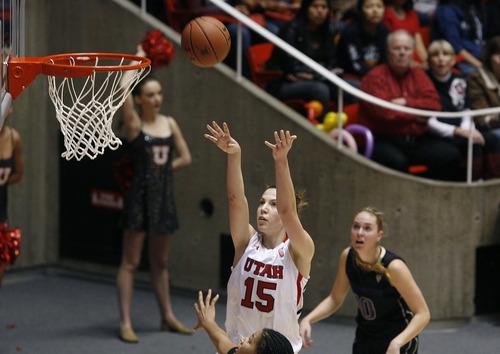 Scott Sommerdorf   |  The Salt Lake Tribune Utah's Michelle Plouffe shoots for two of her 17 points as Utah beat Washington 60-46, Friday, February 22, 2013.
