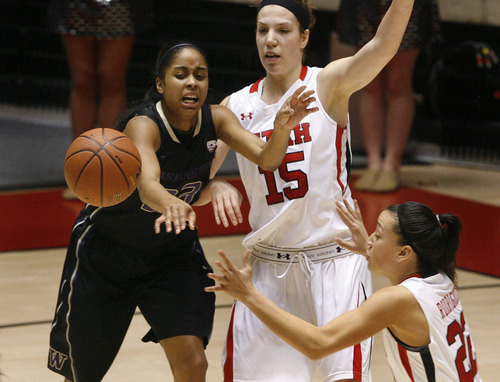 Scott Sommerdorf   |  The Salt Lake Tribune Utah's Michelle Plouffe and Chelsea Bridgewater force a turnover from Washington's Aminah Williams during second half play. Utah beat Washington 60-46, Friday, February 22, 2013.