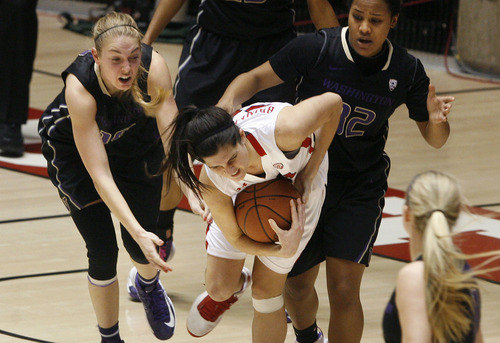 Scott Sommerdorf   |  The Salt Lake Tribune Chelsea Bridewater fights as she grabs a loose ball for the Utes late in the second half as Utah beat Washington 60-46, Friday, February 22, 2013.