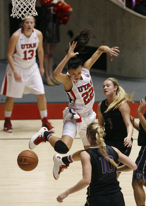 Scott Sommerdorf   |  The Salt Lake Tribune Utah's Danielle Rodriguez is fouled as she has the ball stripped driving for a layup during second half play. Utah beat Washington 60-46, Friday, February 22, 2013.
