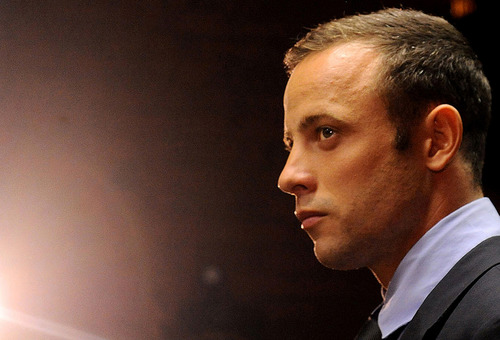 Olympic athlete, Oscar Pistorius , in court Friday Feb. 22, 2013 in Pretoria, South Africa, for his bail hearing charged with the shooting death of his girlfriend, Reeva Steenkamp. The defense and prosecution both completed their arguments with the magistrate soon to rule if the double-amputee athlete can be freed before trial or if he must stay behind bars pending trial) (AP Photo)
