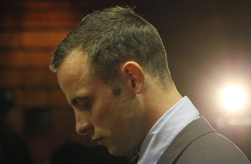 Olympic athlete Oscar Pistorius stands in the dock during his bail hearing at the magistrates court in Pretoria, South Africa, Friday, Feb. 22, 2013. (AP Photo/Themba Hadebe)