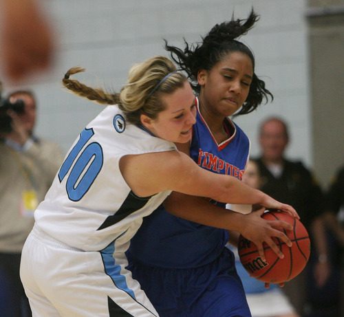 Steve Griffin | The Salt Lake Tribune  Timpview's Lauryn Dela Cruz, right, gets fouled by Sky View's McKenley Hellstern during their 4A state playoff game at Salt Lake Community College in West Valley City, Utah Friday February 22, 2013.
