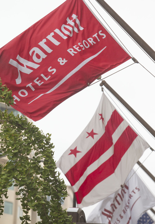 Marriott flags hang at a hotel in Washington, D.C., U.S. on Wednesday, July 14, 2010. Andrew Harrer/Bloomberg