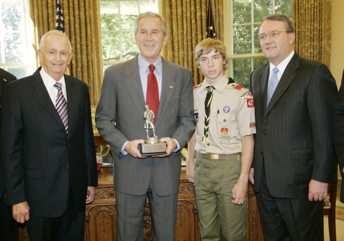From left to right, Bill Marriott Jr., Advisory Board of the Boy Scouts of America, President Bush, CJ McWilliams,15 years-old, Youth Member of Boy Scouts of America, and Jack Gerard, President, National Capital Area Council, Boy Scouts of America, pose for a photo of the  National Capital Area Council of Boy Scouts, Tuesday, July 18, 2006 in the Oval Office of the White House in Washington. (AP Photo/Pablo Martinez Monsivais)