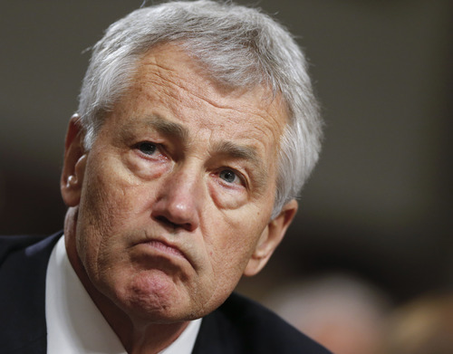 FILE - In this Jan. 31, 2013 file photo, former Nebraska Sen. Chuck Hagel testifies at his Senate Armed Services Committee confirmation hearing on Capitol Hill in Washington. The fierce Republican opposition to President Barack Obama's choice of Hagel to be defense secretary is both personal and business, and the nasty fight long has been seen as a proxy for the never-ending scuffles between the Democratic president and congressional Republicans. Barring any surprises, the drawn-out battle over his nomination probably will end this coming week with his Senate confirmation. But Hagel's fellow Republicans have roughed him up. (AP Photo/J. Scott Applewhite, File)Show was coinci