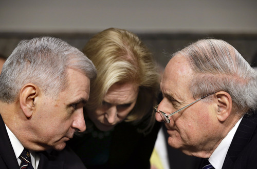 FILE – In this Jan. 31, 2013, file photo Democrat senators, from right, Carl Levin, D-Mich., Chairman of the Senate Armed Services Committee, Kirsten Gillibrand, D-N.Y., and Jack Reed, D-R.I., confer as Republican Chuck Hagel, a former two-term senator and President Obama's choice for defense secretary, testifies at his confirmation hearing on Capitol Hill in Washington. The fierce Republican opposition to the Hagel's nomination has long been seen as a proxy for the never-ending scuffles between the Democratic president and congressional Republicans, with barely any reservoir of good will. Barring any surprises, the battle will probably end this coming week with Hagel's Senate confirmation; but his fellow Republicans have roughed him up.  (AP Photo/J. Scott Applewhite)