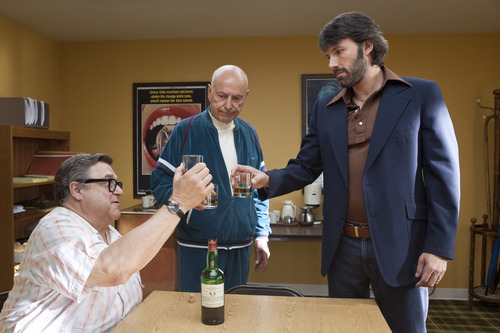 """This image released by Warner Bros shows John Goodman, left, Alan Arkin, center, and actor-director Ben Affleck in a scene from """"Argo.""""  Arkin was nominated  for an Academy Award for best supporting actor on Thursday, Jan. 10, 2013, for his role in """" Argo.""""  The 85th Academy Awards will air live on Sunday, Feb. 24, 2013 on ABC. (AP Photo/Warner Bros., Claire Folger)"""